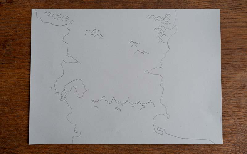 Berge und Bäume in die Schatzkarte malen